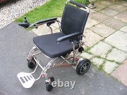 Lightweight Folding Electric Wheelchair 4 Months from New. Used indoors