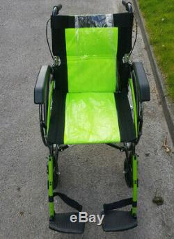 Lightweight small folding green self propelled wheelchair with attendant brakes