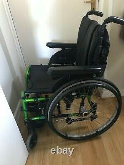 Quickie Neon Lightweight Folding manual wheelchair With Swing-Away Footrests