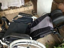 Wheelchair, reclining, foldable, lightweight, with headrest and leg supports